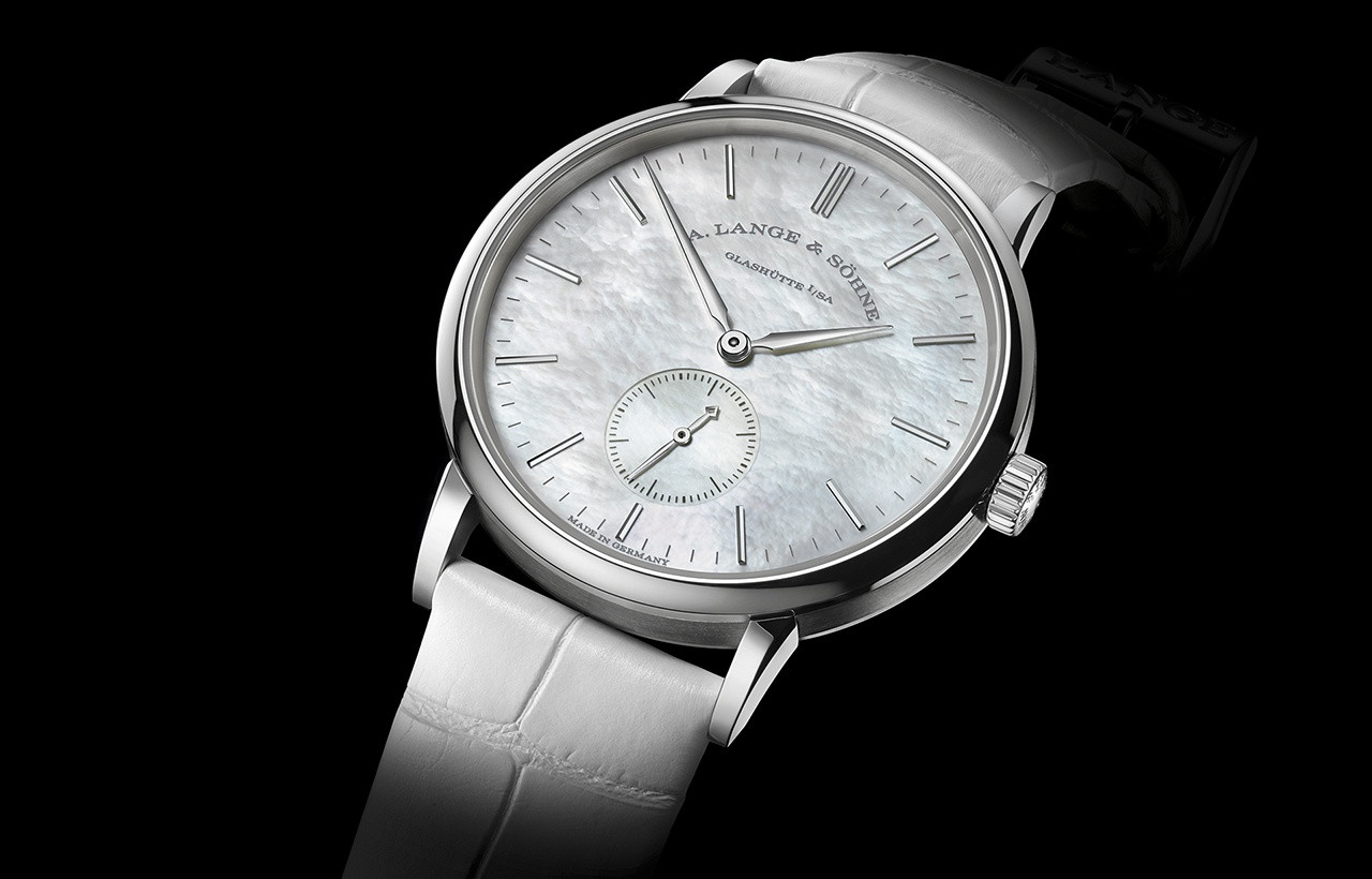 The platinum copy watches have white mother-of-pearl dials.