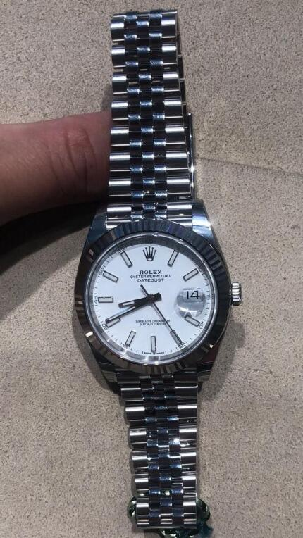 Forever knock-off watch is clear with white dial.